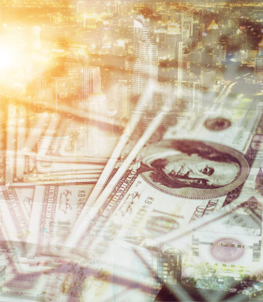Double exposure of money with cityscape blurred building background.